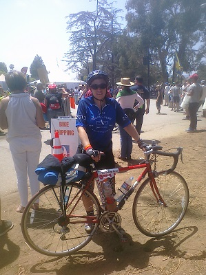 Me and my steed after the ride, with the finish line just behind me.
